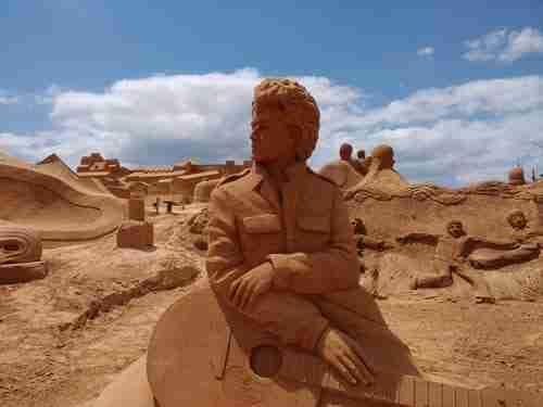 Arte em Areia com Bob Dylan e Beatles